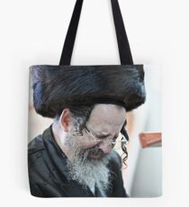Praying in the Ohel of Rabbi Elimelech. Harcikn Dank ! A dank ojch zejer!   Featured in  Hat Heads. Tote Bag