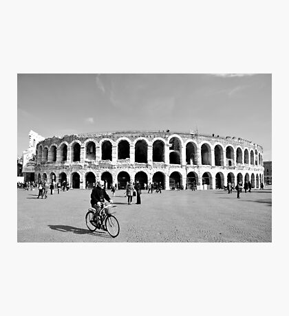 Cycling by the Arena Photographic Print