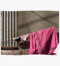Pink sari and a pink plastic lid Poster