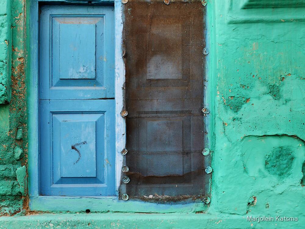 Blue doors in a (very) green wall by Marjolein Katsma