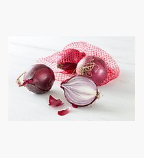 Shallots in the net on white wooden table Photographic Print
