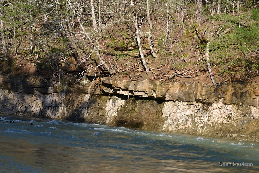 Rockface Beside A Creek by Sean Paulson