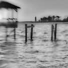 broken pier and lighthouse  by leapdaybride