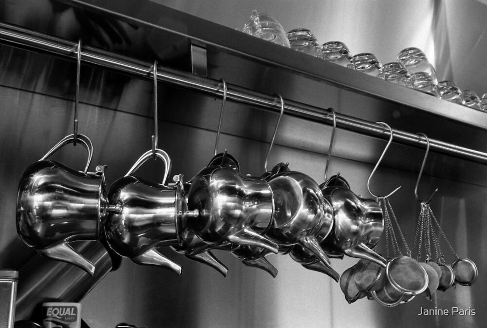 hanging teapots by Janine Paris