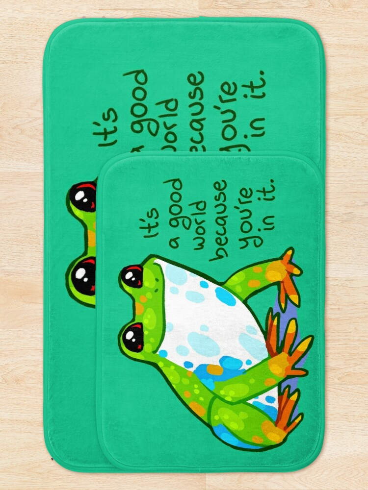 """Alternate view of """"It's a good world because you're in it"""" Frog Bath Mat"""