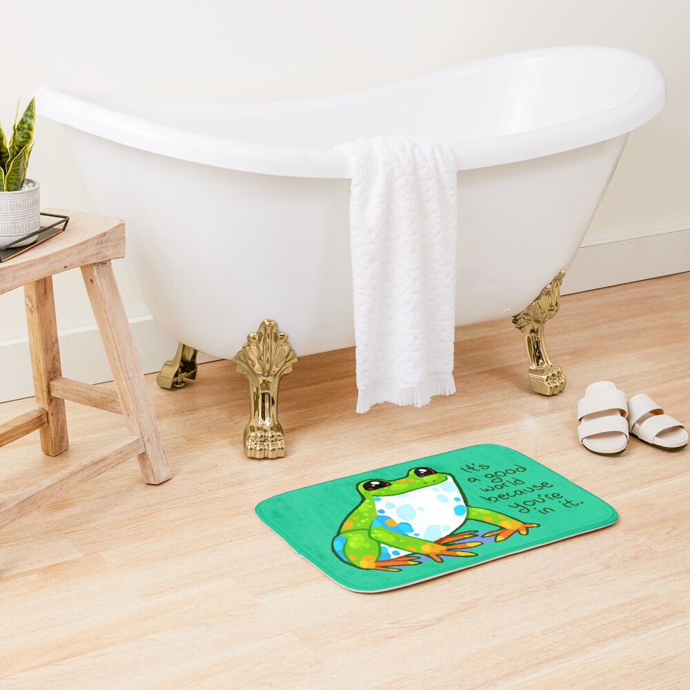 """""""It's a good world because you're in it"""" Frog Bath Mat"""