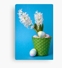Easter composition  with white hyacinth and painted eggs Canvas Print