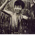 Vietnam ~ Boy in the Field by Yves Schiepek
