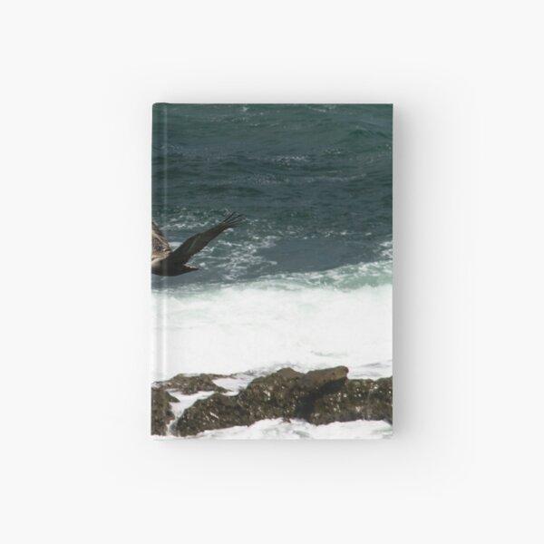 Pelican Flying Over Ocean Hardcover Journal
