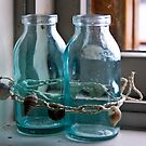Glass Bottles on the Window Sill in Marblehead by Rebecca Dru
