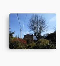 A Thatched Cottage on a Sunny Spring Day Canvas Print