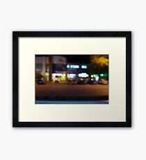 Night urban scene with blurred lights and the shopping center Framed Print