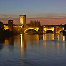 A night walk in Verona: View of Adige River and Castelvecchio Bridge from Ponte della Vittoria  by presbi