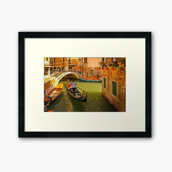 A Gondola Sailing along in the Narrow Canal of Venice, Italy Framed Art Print