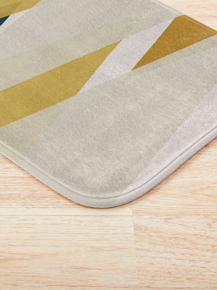 Alternate view of Triangular Abstract in Mustard Yellows, Navy Blue, and Blush Tones. Minimalist Geometric Bath Mat