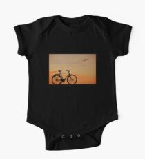 Melancholy is incompatible with bicycling.  Kids Clothes