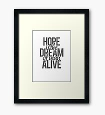 Hope is the dream of a man awake. Framed Print