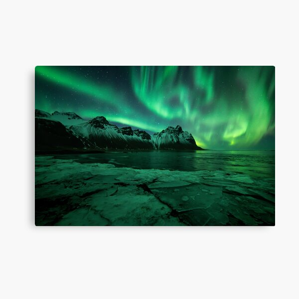 Northern lights Iceland above Vestrahorn mountain in Stokksnes with ice in the foreground Canvas Print