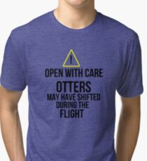Otters may have shifted during the flight. Tri-blend T-Shirt