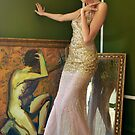 Pretty woman in vintage long gown posing  by Anton Oparin