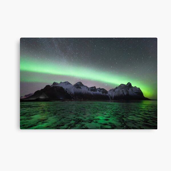 Northern lights and milky way above Vestrahorn mountain in Stokksnes, Iceland with ice in the foreground Canvas Print