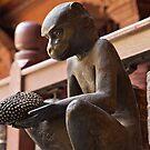Brass monkey offering jackfruit, Patan, Nepal by John Spies