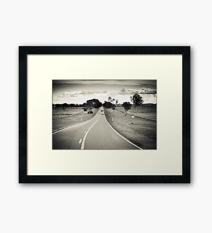 Riding the long road Framed Print