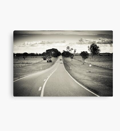 Riding the long road Canvas Print