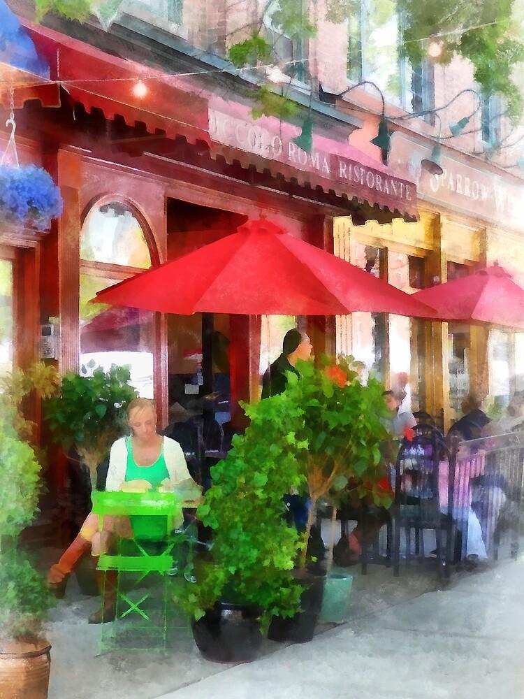 Outdoor Cafe With Red Umbrellas by Susan Savad