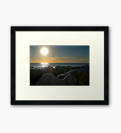 Sunset on the rocks Framed Print