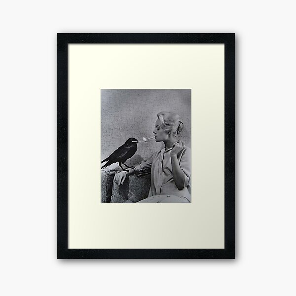 Tippi Hedren having her cigarette lit by a crow on the set of The Birds Framed Art Print