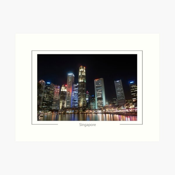 Singapore Skyscrapers of the business district reflected in the Singapore River at night. Art Print