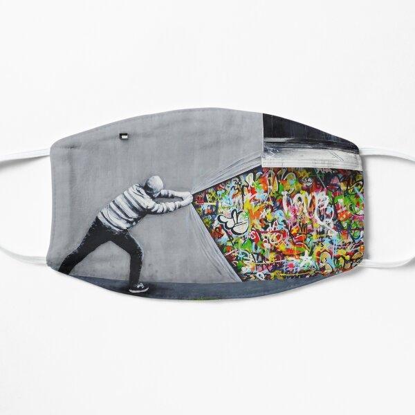 Banksy uncovering graffiti Mask