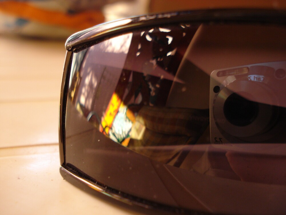Sony Cybershot camera reflection on Reef Sunglasses by KPolster