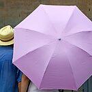 Sheltering under an umbrella by Sami Sarkis