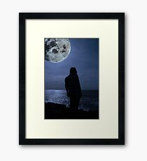 silhouette of a sad lone woman with a full moon on a cliff edge Framed Print