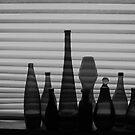 Bottles on the shelf by peterrobinsonjr