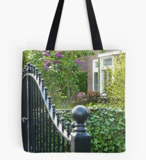 huge gate, small garden Tote Bag