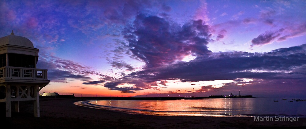 Panoramic spectacular sunset in La Caleta, Cadiz, Spain by Martin Stringer
