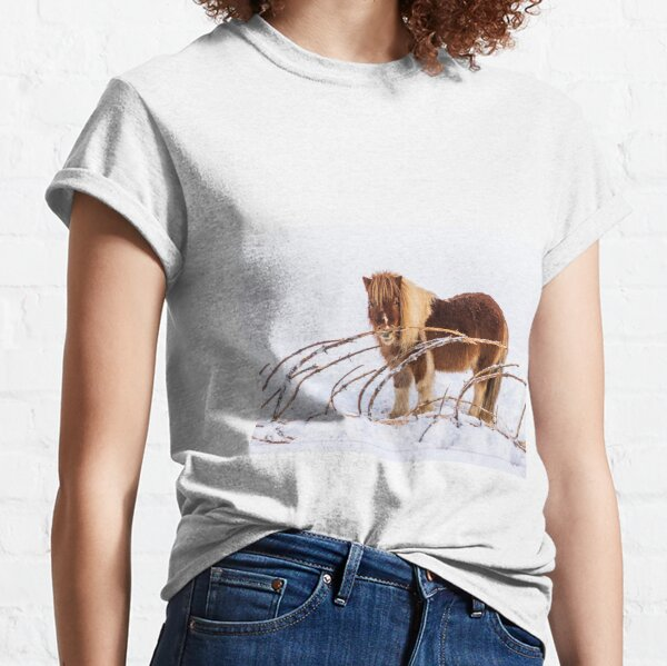 Little horse, pony standing on the snow next tree Classic T-Shirt