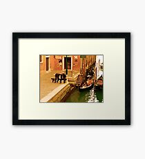Conversation by the Canal Framed Print