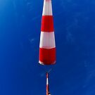 Windsock against blue sky by Sami Sarkis