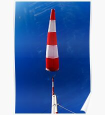 Windsock against blue sky Poster