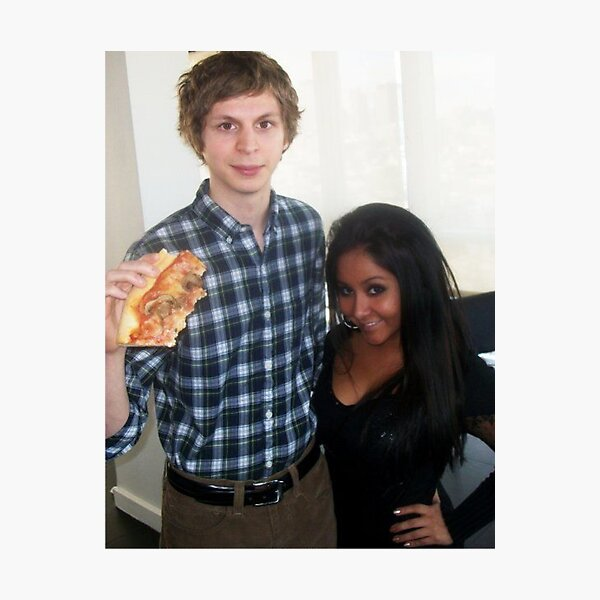 michael cera holding a large pizza next to snooki Photographic Print