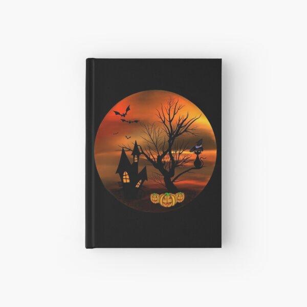 Halloween Katze mit Zauberhut in einem blattlosen Baum, leuchtende Kürbisse, Fledermäuse und eine alte Villa Notizbuch