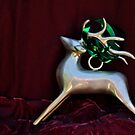 Christmas:  Silver Reindeer Floating on a Deep Red Tree Skirt by Jen Waltmon