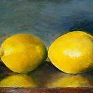 two lemons on a varnished surface by Jeremy Wallace