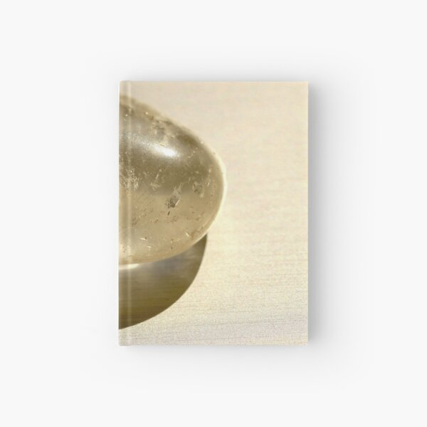 Quartz crystal in white on silver background  Hardcover Journal