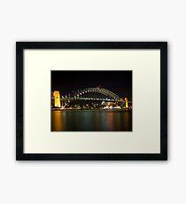 bridge over vivid water Framed Print