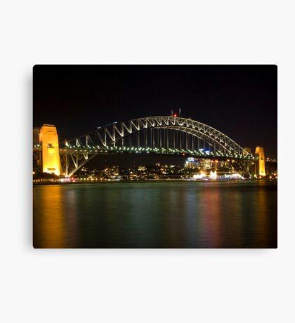 bridge over vivid water Canvas Print